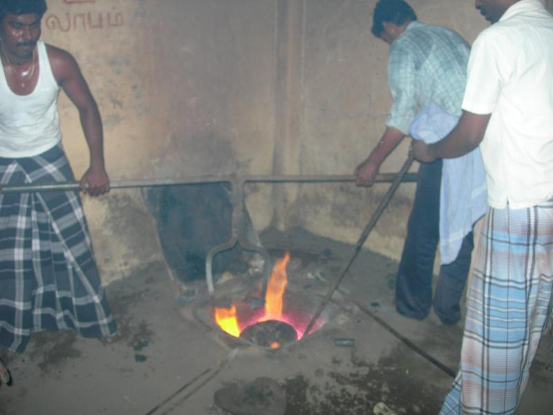 TAKING OUT THE PANCHALOGHA METAL AFTER MELTING FROM THE FURNESS