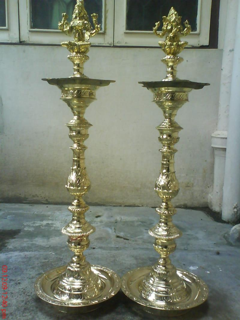 ORNAMENTAL BRASS LAMP WITH LAKSHMI AND GANESHA ON TOP